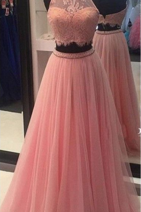 A pink high-necked lace ball gown