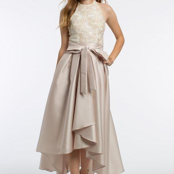 The halter neckline, embroidered fitted bodice, satin tie sash, box pleated high low skirt, and open back make this a unique prom dress